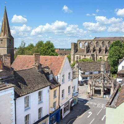 View of Malmesbury Abbey and other listed buildings